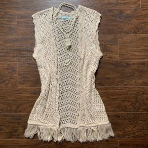 Cream crocheted cardigan with frayed bottom